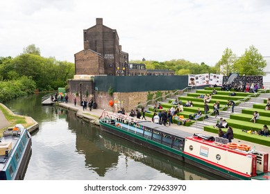 London, UK - April 2017: Granary Square steps reaching the canal, carpeted in green during the summer months. Granary Square is a public square on the banks of Regent's Canal, London, UK