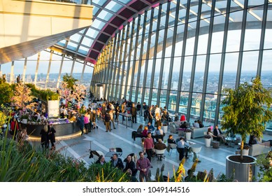 London, UK - April 2017: People enjoying the spectacular Sky Garden situated on the top floor of 20 Fenchurch Street skyscraper, offers a bar, restaurant and great views of London