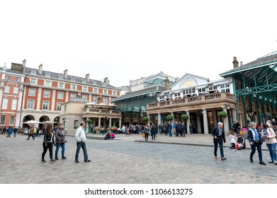 London, UK - April 2018: Covent Garden Market, a place for fashionable retail stores and dining on popular tourist site surrounded by historical buildings, theatres and entertainment facilities