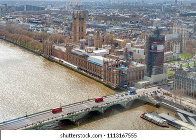 London, UK - April 2018: The Elizabeth Tower, the Great Clock and the Great Bell, known as Big Ben, the iconic landmark of London, and the Palace of Westminster being scaffolded during the renovation