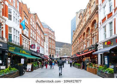 London, UK - April 2018: Shops and restaurants located along both sides of Irving Street at Leicester Square