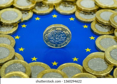 LONDON, UK - APRIL 2019: Close up view of British currency GBP - One Pound coin balance on its edge in the centre of the logo of the European Union.