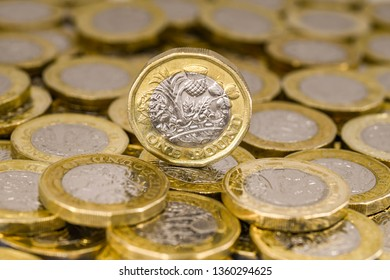 LONDON, UK - APRIL 2019: Close up view of British currency GBP - One Pound coin standing on its edge