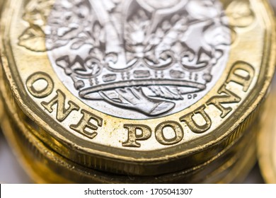 LONDON, UK - APRIL 2020: Close up view of the bottom edge of a British currency GBP - One Pound coin