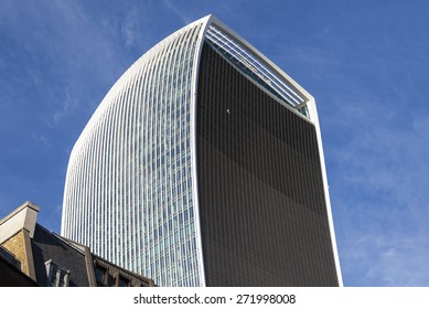 LONDON, UK - APRIL 20TH 2015: Looking up at the impressive 20 Fenchurch Street skycraper (nicknamed the Walkie Talkie building) in the City of London on 20th April 2015.