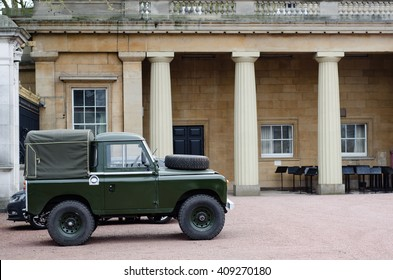 LONDON, UK - APRIL 21, 2016  Land Rover Defender in the grounds of Buckingham Palace. Old style green short wheel-base vehicle parked in the grounds of the London home of Queen Elizabeth II