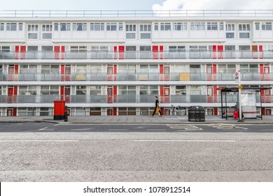 London, UK - April 21, 2018 -  A man carrying a supermarket bag walking by Churchill Gardens, a large housing estate in the Pimlico area