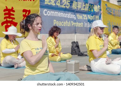 London UK - April 21 2019 Falun Gong devotees gathered in Trafalgar Square London to protest the Chinese governments alleged persecution of their movement