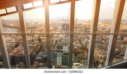 LONDON, UK - APRIL 22, 2015: London city view through the big glass windows