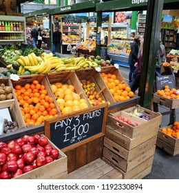 LONDON, UK - APRIL 22, 2016: People shop at Borough Market in Southwark, London. It is one of oldest markets in Europe. Its 1,000th birthday was in 2014.