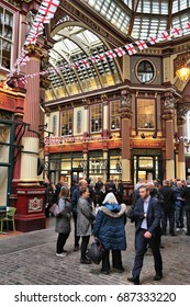 LONDON, UK - APRIL 22, 2016: People celebrate Saint George's Day in Leadenhall Market, London. Saint George is the patron saint of England.