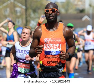 London, UK - April 22 2018: Runners in the London Marathon collecting water at the 16 mile stage in Docklands