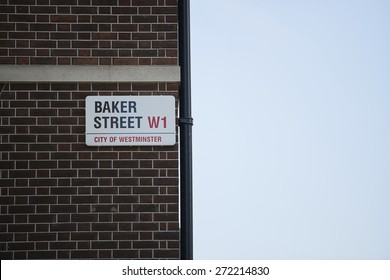 LONDON, UK - APRIL 22: Baker Street sign affixed on dark brick wall next to drainage pipe. April 22, 2015 in London.  The street was brought to fame by Sherlock Holmes's adventures.