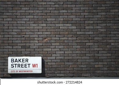 LONDON, UK - APRIL 22: Dark brick wall with Baker Street sign at the bottom corner. April 22, 2015 in London.  The street was brought to fame by Sherlock Holmes's adventures.