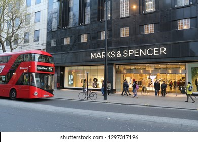 LONDON, UK - APRIL 23, 2016: People shop at Marks & Spencer, Oxford Street in London. Oxford Street has approximately half a million daily visitors and 320 stores.