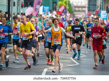 London, UK - April 23, 2017: Happy Marathon runner in costume cheering by public. Charity money raise.