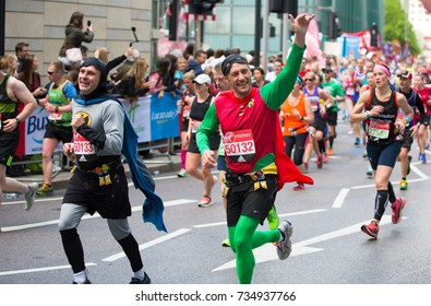 London, UK - April 23, 2017: Happy Marathon runner in costume cheering by public. Charity money raise.