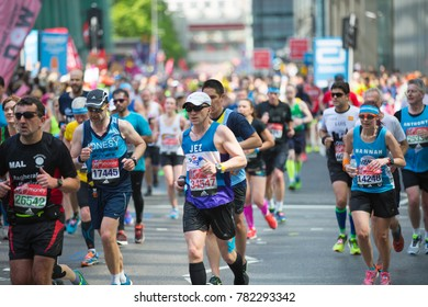 London, UK - April 23, 2017: Lots of people running in London Marathon. People cheering the sportsmen in Canary Wharf