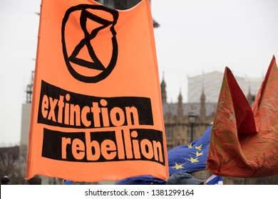 LONDON, UK - April 23, 2019: Protestors with Extinction Rebellion flags at a protest in London
