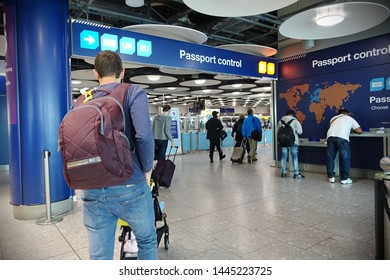 London, UK - April 24, 2019: Air travelers proceed to border control at Heathrow Airport. EU passengers face uncertainty as the UK is due to leave the EU with a no deal on brexit a possibility.