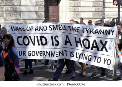 London, UK - April 24, 2021: 'Unite for Freedom' protest by covid-19 sceptics, demonstrators opposing lockdown, vaccination, mask-wearing and health passports.
