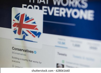 LONDON, UK - APRIL 25th 2017: The official twitter site of the UK Conservative political party photographed on a laptop computer screen