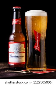 LONDON, UK - APRIL 27, 2018: Glass bottle of Budweiser Beer on wooden background with label, an American lager first introduced in 1876.
