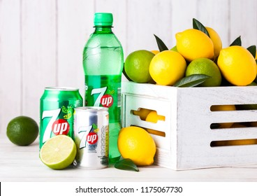 LONDON, UK - APRIL 27, 2018: Plastic bottle of 7UP lemonade soda drink with fresh lemons and limes.This refreshment drink produce Pepsi company.