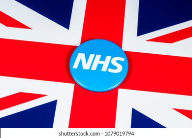 LONDON, UK - APRIL 27TH 2018: The National Health Service symbol over the UK flag, on 27th April 2018.  The NHS was established in 1948 as one of the major social reforms following the 2nd World War.
