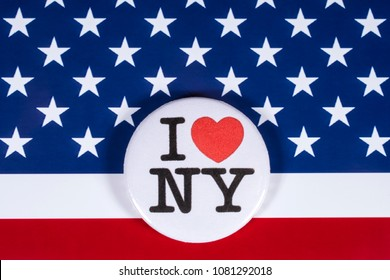 LONDON, UK - APRIL 27TH 2018: An I Love New York badge pictured over the USA flag, on 27th April 2018.