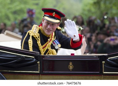 LONDON, UK - APRIL 29: Prince Harry rides in a carriage on his way to Buckingham Palace after the Royal Wedding of his brother Prince William to Catherine Middleton on the April 29 in London, UK