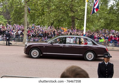 LONDON, UK - APRIL 29: Queen Elizabeth and the Duke of Edinburgh in their Rolls-Royce at Prince William and Kate Middleton wedding, April 29, 2011 in London, United Kingdom