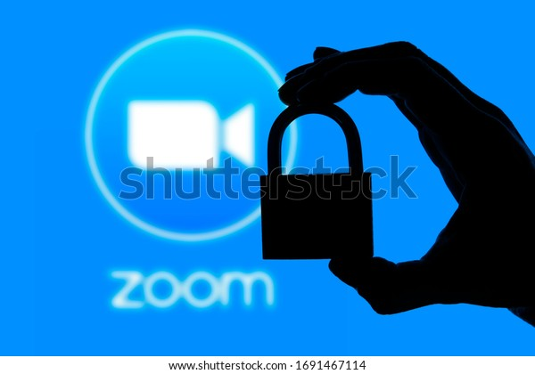 LONDON, UK - April 2nd 2020: Zoom video conference app icon with silhouette of a padlock