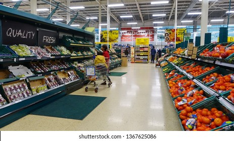 London, UK - April 4, 2019: Shoppers browse an aisle in a Tesco supermarket. Britain's Tesco is the world's third largest supermarket retailer after America's Walmart and France's Carrefour.
