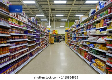 London, UK - April 4, 2019: Food items are seen in an aisle of a Tesco supermarket. Britain's Tesco is the world's third largest supermarket retailer after America's Walmart and France's Carrefour.