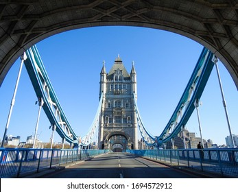 London / UK - April 5th 2020: Tower Bridge in London a very busy road and tourist attraction is empty as people are told to self isolate and stay at home during the COVID-19 coronavirus pandemic