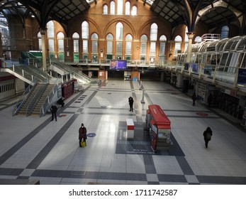 London / UK - April 5th 2020: Liverpool Street Station and Bishopsgate a very busy road is empty as people are told to self isolate and stay at home during the COVID-19 coronavirus pandemic