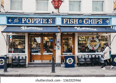London, UK - April 6, 2019: People walking past Poppie's in Spitalfields, London, a famous fish & chips shop that has been serving since 1952.