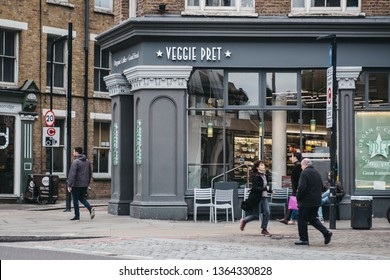 London, UK - April 6, 2019: People walking past Pret A Manger, London, an international sandwich shop chain based in UK and has approximately 500 shops in nine countries.