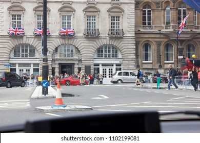 LONDON, UK, APRIL 6TH, 2012: In-car driver view of tourists crossing the road on St Jame's Street W1