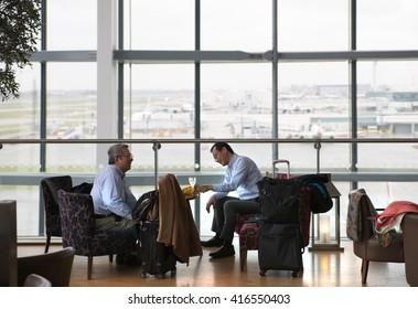 LONDON, UK - APRIL 7, 2016: Businessmen having a drink in departure launch of Heathrow airport