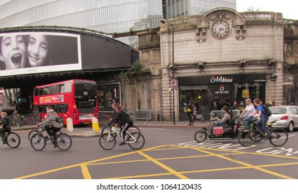 LONDON/ UK- APRIL 7, 2018: A group of cyclists riding on a busy London road.