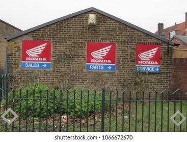 LONDON/ UK- APRIL 7, 2018: Retro Honda motorcycle symbols from the 1960s, on wall in Dagenham, London.