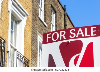 London, UK - April 8, 2017 - For Sale sign outside a English townhouse