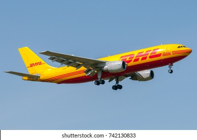 London, UK, April 9th 2011: an aircraft of international freight DHL in short final for landing at Heathrow.