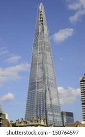"LONDON, UK - AUG 19: Renzo Piano designed 'The Shard' in London on August 19, 2013. 310 meters tall and still much available space, ""all will be fully let by Dec 2014"" says developer Irvine Sellar."