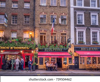 LONDON UK - AUG 2: London pubs and restaurants in the Covent Garden area on August 2, 2017 in London England. London has many beautiful and popular pubs, bars and restaurants.