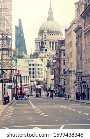 London, UK; Aug 2014: A street view of London with St Pauls Cathedral and The Shard