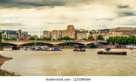 London, U.K, Aug 2018, urban scene view from the Thames riverbank on a overcast day