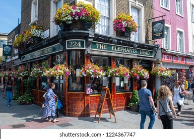 LONDON, UK - AUG 21: Tourists and locals walk in front of The Elephants Head pub in Camden Town, London on August 21, 2013. Camden Town is one of London's most popular market and nightlife areas